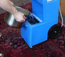 Pouring Carpet Cleaning Liquid into Rental Carpet Cleaner